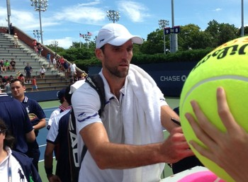 Ivo Karlovic signing autographs after qualifying for the main draw of the U.S Open