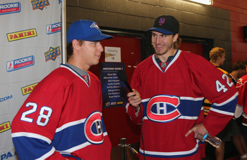 Montreal Canadiens defensemen Jarred Tinordi (right) and Nathan Beaulieu.
