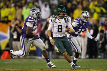 Mariota runs loose against Kansas State.