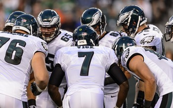 Aug 9, 2013; Philadelphia, PA, USA; Philadelphia Eagles quarterback Michael Vick (7) in the huddle\ during the first quarter against the New England Patriots at Lincoln Financial Field. The Patriots defeated the Eagles 31-22. Mandatory Credit: Howard Smit