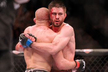 UFC welterweight Carlos Condit (right) following his loss to champion Georges St-Pierre