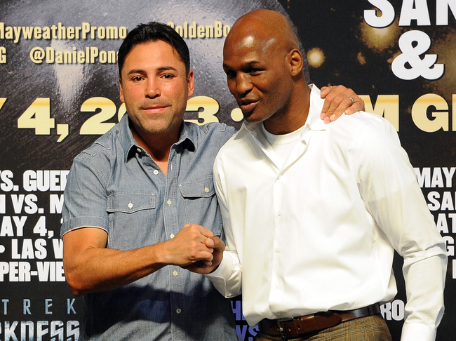 May 3, 2013; Las Vegas, NV, USA;  Champion fighters Oscar de la Hoya (left) and Bernard Hopkins on stage during the weigh in for the Floyd Mayweather / Robert Guerrero (not pictured) WBC Welterweight title fight at the MGM Grand Garden Arena. Mandatory Cr