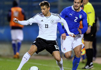 Hi-res-160816442-giulio-donati-of-italy-competes-for-the-ball-with_display_image