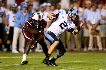 Jadeveon Clowney gets pressure on UNC QB Bryn Renner.