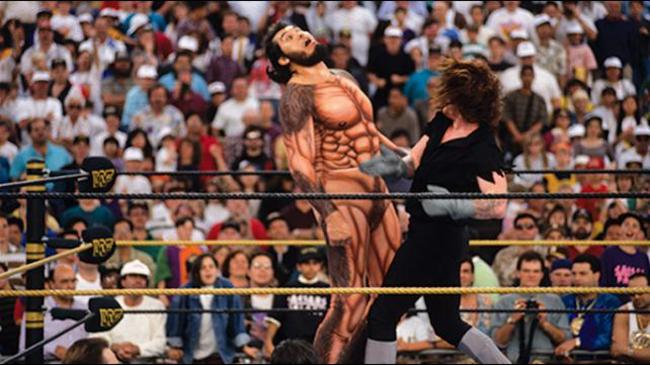 The Undertaker uppercuts Giant Gonzales (Photo by WWE)