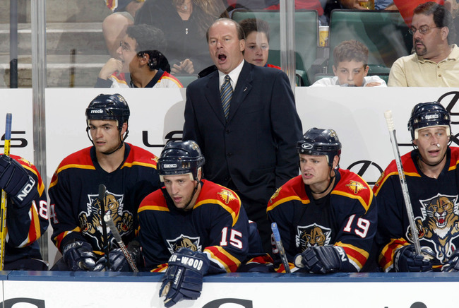 SUNRISE, FL - OCTOBER 9:  Head Coach Mike Keenan of the Florida Panthers yells at his team against the Carolina Hurricanes on October 9, 2003 at the Office Depot Center in Sunrise, Florida.  (Photo by Eliot J. Schechter/Getty Images)