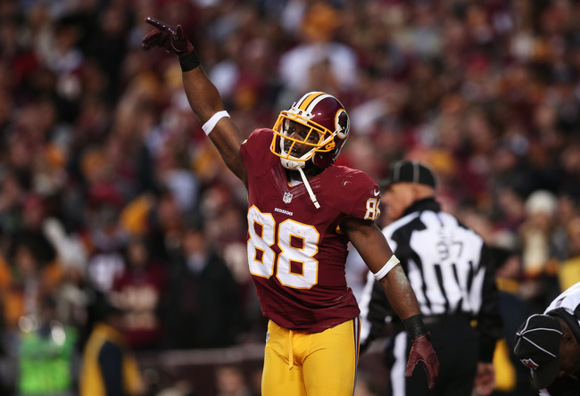 LANDOVER, MD - JANUARY 06:  Pierre Garcon #88 of the Washington Redskins celebrates their first quarter touchdown against the Seattle Seahawks during the NFC Wild Card Playoff Game at FedExField on January 6, 2013 in Landover, Maryland.  (Photo by Win McN