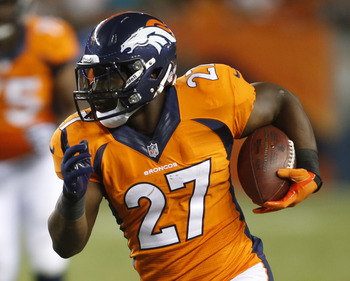 Aug 24, 2013; Denver, CO, USA; Denver Broncos running back Knowshon Moreno (27) runs the ball during the second half against the St. Louis Rams at Sports Authority Field at Mile High. The Broncos won 27-26.  Mandatory Credit: Chris Humphreys-USA TODAY Spo