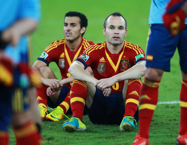 RIO DE JANEIRO, BRAZIL - JUNE 30:  Andres Iniesta (R) and Pedro Rodriguez of Spain look dejected in defeat after the FIFA Confederations Cup Brazil 2013 Final match between Brazil and Spain at Maracana on June 30, 2013 in Rio de Janeiro, Brazil.  (Photo b