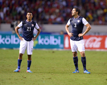 Sep 6, 2013; San Jose, COSTA RICA; United States players Michael Orozco (21) and Omar Gonzalez (3) react against Costa Rica in a FIFA World Cup Qualifier at Estadio Nacional. Costa Rica defeated the United States 3-1. Mandatory Credit: Kirby Lee-USA TODAY
