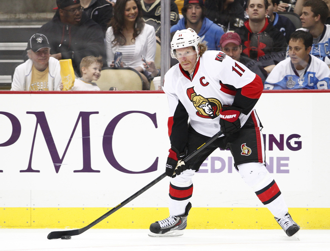 PITTSBURGH, PA - MAY 14: Daniel Alfredsson #11 of the Ottawa Senators skates against the Pittsburgh Penguins in Game One of the Eastern Conference Semifinals during the 2013 NHL Stanley Cup Playoffs at Consol Energy Center on May 14, 2013 in Pittsburgh, P