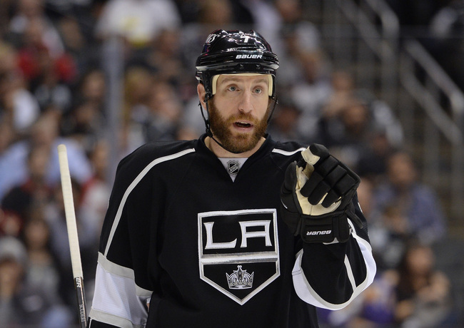 LOS ANGELES, CA - JUNE 04:  Defenseman Rob Scuderi #7 of the Los Angeles Kings speaks to a teammate during a break in action in the third period of Game Three of the Western Conference Final against the Chicago Blackhawks during the 2013 NHL Stanley Cup P