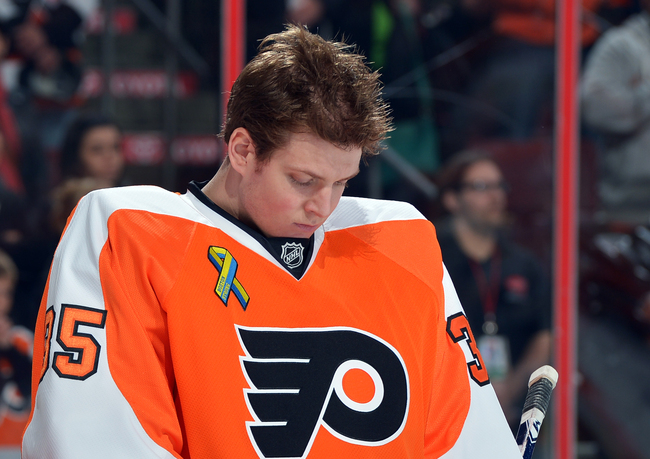 PHILADELPHIA, PA - APRIL 23: Steve Mason #35 of the Philadelphia Flyers bows his head during a moment of silence in honor of the families and victims of the Boston Marathon bombing before the game against the Boston Bruins at the Wells Fargo Center on Apr