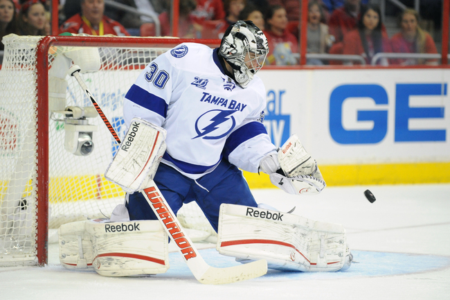 WASHINGTON, DC - APRIL 7:   Ben Bishop #30 of the Tampa Bay Lightning makes a save during a NHL hockey game against the Washington Capitals on April 7, 2013 at the Verizon Center in Washington, DC.  (Photo by Mitchell Layton/Getty Images)
