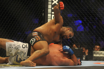 Daniel Cormier (top) faces Dion Staring earlier this year in Strikeforce.