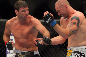 Michael Bisping (left) fights Alan Belcher earlier in 2013.