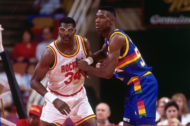 Hi-res-82650073-hakeem-olajuwon-of-the-houston-rockets-defends-dikembe_crop_650