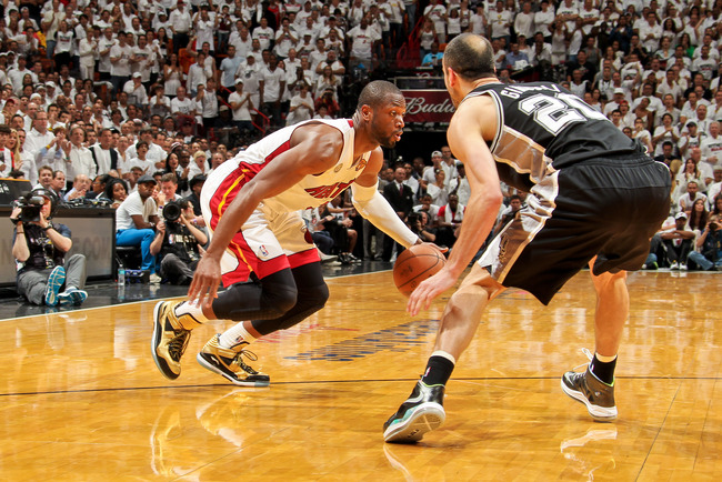 Hi-res-170092672-dwyane-wade-of-the-miami-heat-drives-against-manu_crop_650