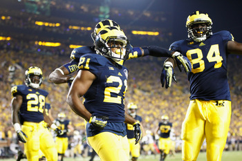 Michigan teammates celebrate after a Jeremy Gallon (21) touchdown against Notre Dame.