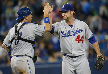 Dodger pitcher Chris Withrow getting congratulations from catch A.J. Ellis