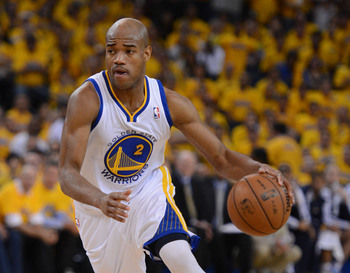 May 2, 2013; Oakland, CA, USA; Golden State Warriors point guard Jarrett Jack (2) dribbles against the Denver Nuggets during the first quarter of game six of the first round of the 2013 NBA Playoffs at Oracle Arena. Mandatory Credit: Kyle Terada-USA TODAY