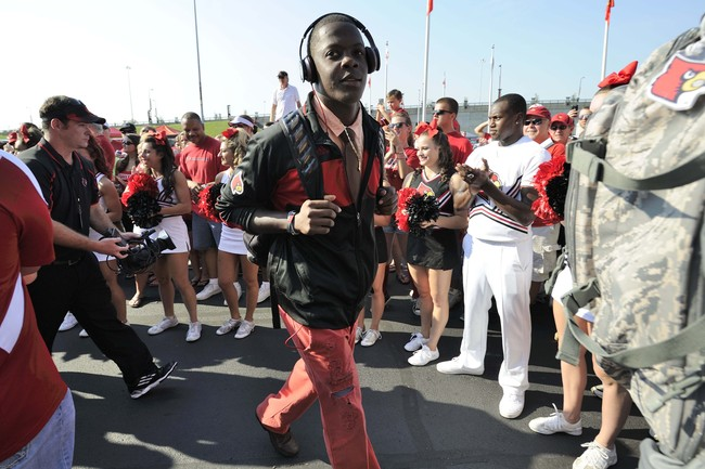 Sep 7, 2013; Louisville, KY, USA; Louisville Cardinals quarterback Teddy Bridgewater (5) walks to the stadium during the Card March before the game against the Eastern Kentucky Colonels at Papa John's Cardinal Stadium. Mandatory Credit: Jamie Rhodes-USA T
