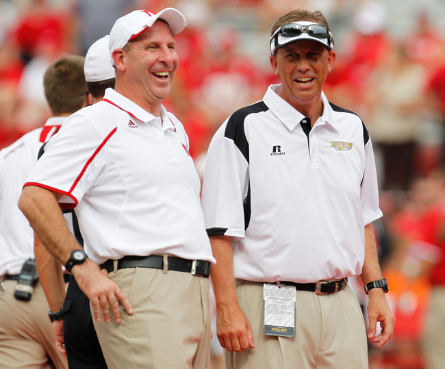 Sep 7, 2013; Lincoln, NE, USA; Nebraska Cornhuskers head coach Bo Pelini and Southern Mississippi Golden Eagles head coach Todd Monken laugh prior to the game at Memorial Stadium. Mandatory Credit: Bruce Thorson-USA TODAY Sports