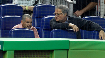 Is Marlins owner Jeffrey Loria, right, telling his ex-wife's son, team president David Samson, he's getting fired? Only Loria knows.