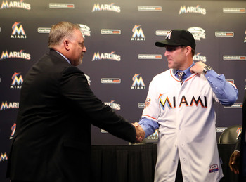 Marlins president of baseball operations Larry Beinfest, left, and manager Mike Redmond should retain their jobs for the 2014 season.