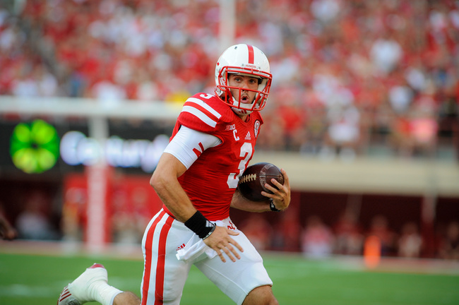LINCOLN, NE - SEPTEMBER 7: Quarterback Taylor Martinez #3 of the Nebraska Cornhuskers scrambles during their game against the Southern Miss Golden Eagles at Memorial Stadium on September 7, 2013 in Lincoln, Nebraska. (Photo by Eric Francis/Getty Images)