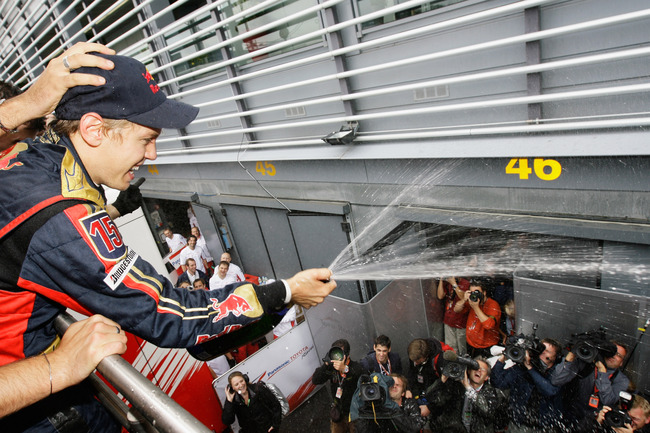 MONZA, ITALY - SEPTEMBER 14:  Sebastian Vettel of Germany and Scuderia Toro Rosso sprays champage as he celebrates with team mates in the paddock after winning the Italian Formula One Grand Prix at the Autodromo Nazionale di Monza on September 14, 2008 in
