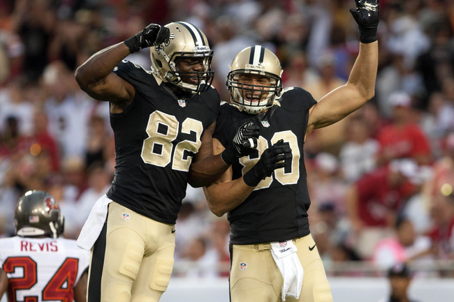 Sep 15, 2013; Tampa, FL, USA; New Orleans Saints tight end Benjamin Watson (82) celebrates with tight end Jimmy Graham (80) after Graham scores a touchdown during the game against the Tampa Bay Buccaneers at Raymond James Stadium. Mandatory Credit: Rob Fo