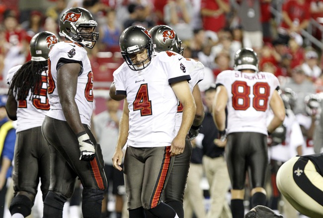 Sep 15, 2013; Tampa, FL, USA; Tampa Bay Buccaneers kicker Rian Lindell (4) reacts after he missed a field goal during the fourth quarter against the New Orleans Saints  at Raymond James Stadium. The Saints won 16-14. Mandatory Credit: Kim Klement-USA TODA
