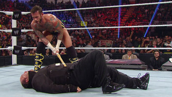 CM Punk gets his revenge on Paul Heyman. Photo by: WWE