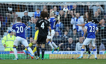 David Luiz finds himself behind a number of Everton players, as Naismith makes it 1-0.
