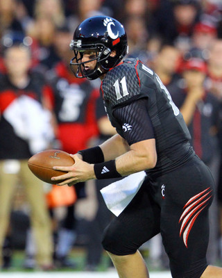 Sep 14, 2013; Cincinnati, OH, USA; Cincinnati Bearcats quarterback Brendon Kay (11) hands the ball off to running back Hosey Williams (not pictured) during the game against the Northwestern State Demons at Nippert Stadium. Mandatory Credit: Rob Leifheit-U