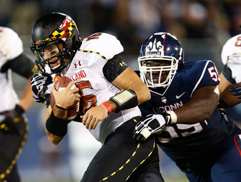 Sep 14, 2013; East Hartford, CT, USA; Maryland Terrapins quarterback C.J. Brown (16) is tackled by Connecticut Huskies defensive tackle Shamar Stephen (right) during the second half at Rentschler Field. Mandatory Credit: Mark L. Baer-USA TODAY Sports