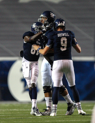 Sep 14, 2013; Houston, TX, USA; Rice Owls kicker Chris Boswell (9) is congratulated after making a field goal during the fourth quarter against the Kansas Jayhawks at Rice Stadium. Mandatory Credit: Troy Taormina-USA TODAY Sports