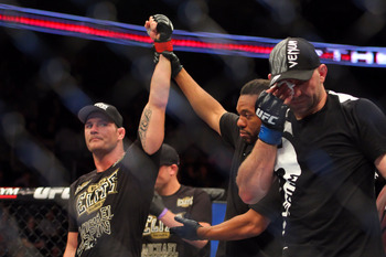 Michael Bisping (left) after defeating Alan Belcher in 2013.