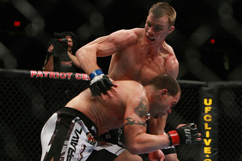 Jesse Forbes (top) faces Nick Catone in 2010. (Photo credit: Dave Mandel/Sherdog)