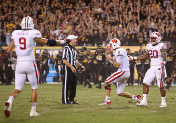 Wisconsin quarterback Joel Stave (No. 2) complains to an official after time expired in the fourth quarter.