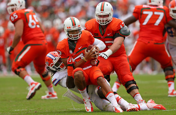 QB Stephen Morris gets wrapped up against Florida