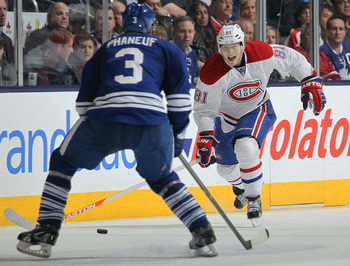 Montreal Canadiens forward Lars Eller takes on Toronto Maple Leafs defenseman Dion Phaneuf.