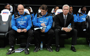 Pardew, along with Steve Stone (left) and John Carver (centre), signed an eight-year deal with Newcastle last year