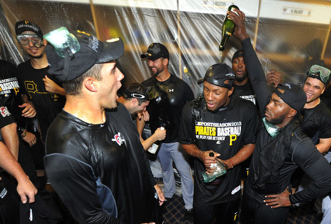 Hi-res-181711658-josh-harrison-of-the-pittsburgh-pirates-pours-champagne_crop_650x440