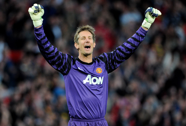 Hi-res-113645231-edwin-van-der-sar-of-manchester-united-celebrates-after_crop_650x440