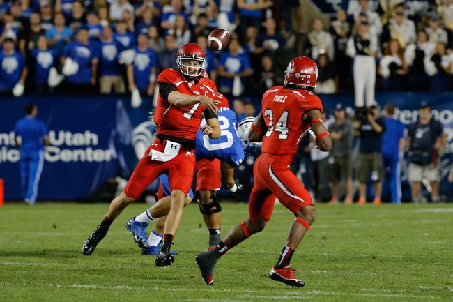 Sep 21, 2013; Provo, UT, USA; Utah Utes quarterback Travis Wilson (7) passes the ball to running back James Poole (34) against the BYU Cougars at Lavell Edwards Stadium.  Utah Utes defeated Brigham Young Cougars 20-13. Mandatory Credit: Chris Nicoll-USA T