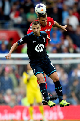 Roberto Soldado is beaten to the ball in the air.
