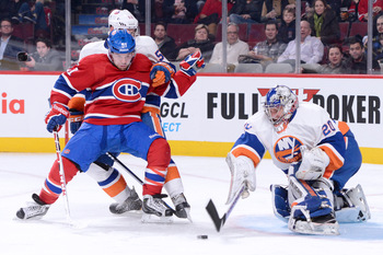 Montreal Canadiens forward David Desharnais in front of New York Islanders goalie Evgeni Nabokov.