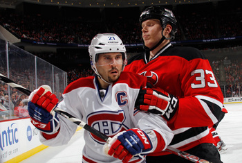 Montreal Canadiens forward Brian Gionta and New Jersey Devils defenseman Alexander Urbom.